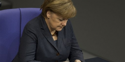 German Chancellor Angela Merkel uses her mobile phone in Berlin in 2011. (AP File Photo/Gero Breloer)