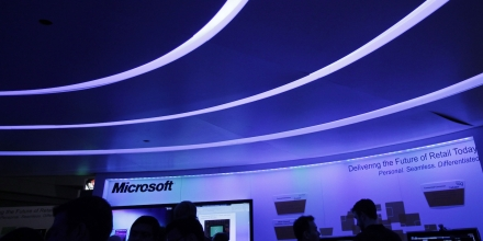 In this Tuesday, Jan. 17, 2012, file photo, attendees at the National Retail Federation visit a Microsoft display in New York. Microsoft Corp. said Monday, June 18, 2012, it will make a