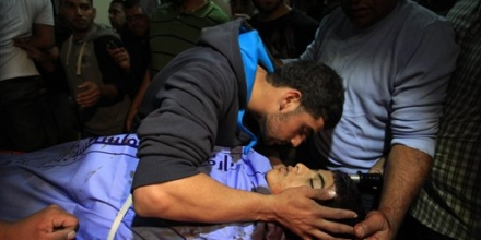 A relative kisses 14-year-old Orwah Hammad, who was killed during clashes with Israeli military, at a hospital in the West Bank city of Ramallah, Friday, Oct. 24, 2014. Hammad, who was born in New Orleans and is an United States citizen, is the second teen to be killed by army fire in eight days. A 13-year-old was killed last week in a West Bank village. (AP Photo/Majdi Mohammed)