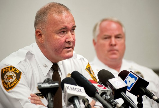 St. Louis County Police Chief Jon Belmar, left, delivers remarks as Ferguson Police Chief Thomas Jackson listens during a news conference Sunday, Aug. 10, 2014 in Ferguson, Mo., where the men addressed issues surrounding the shooting of Michael Brown, 18, by Ferguson police Saturday, Aug. 9, 2014. Brown died following a confrontation with police, according to Belmar. (AP Photo/Sid Hastings)