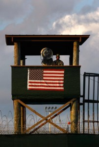 GUANTANAMO BAY, CUBA - MARCH 30:  (EDITORS NOTE: Image has been reviewed by U.S. Military prior to transmission.) A U.S. Army soldier stands watch in a guard tower at Camp Delta in the Guantanamo Bay detention center on March 30, 2010 in Guantanamo Bay, Cuba. U.S. President Barack Obama pledged to close the prison by early 2010 but has struggled to transfer or try the remaining detainees from the facility, located on the U.S. Naval Base at Guantanamo Bay, Cuba.  (Photo by John Moore/Getty Images)
