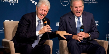 Former Presidents Bill Clinton, left, and George W. Bush
