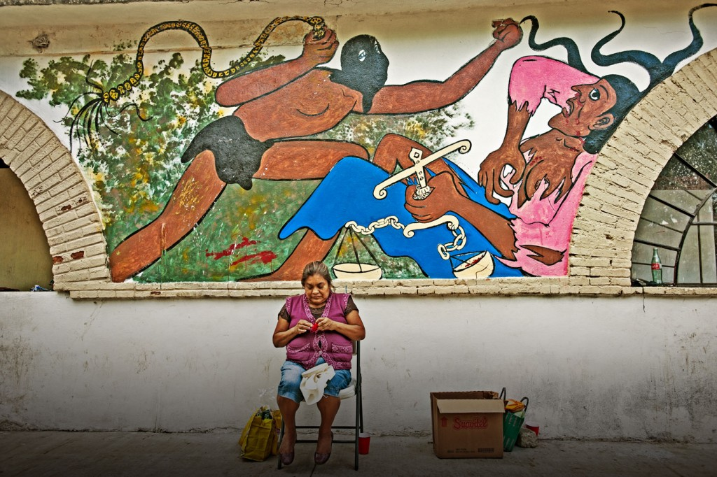 Forty-three male students from the Raul Burgos Rural Teachers College in Ayotzinapa, Guerrero were disappeared on September 26, 2014 at the hands of local police working in conjunction with drug traffickers. The basketball court at the school serves as the nerve center for most activities related to the movement for information and justice that has developed around the case of the missing students. A woman supporter of the students knits while waiting for any news beside the court.