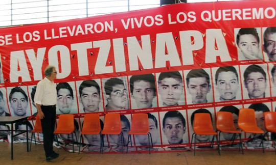 German Human Rights Commissioner Christoph Strässer looks at a huge banner with portraits of the 43 missing students during a meeting at the Rural school of Ayotzinapa, in Tixtla community, Guerrero State, Mexico on February 25, 2015. 43 missing students disappeared on September 26th, when police attacked busloads of college students in Iguala, allegedly under the orders of its mayor, and handed them over to a gang. AFP PHOTO/JESUS GUERRERO        (Photo credit should read JESUS GUERRERO/AFP/Getty Images)