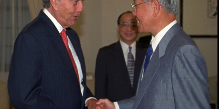 Former U.S. senator and presidential candidate Bob Dole, left, shakes hands with Taiwanese President Lee Teng-hui during a visit to the presidential  office in Taipei on Sunday, July 20, 1997. Lee told Dole, who is on a private visit, that Taiwan's reunification with China can't be handled like Hong Kong, which reverted from British to Chinese rule on July 1. (AP Photo/Kuo Ji Hsiao)
