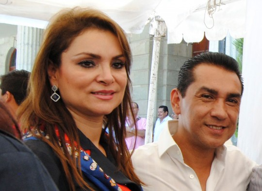 Image #: 32959063    Fugitive former mayor Jose Luis Abarca (R) and his wife Maria de los Angeles Pineda attend an event in Chilpancingo in this March 25, 2014 file photo. Mexican police have captured Abarca and his wife, suspected of being the probable masterminds behind the abduction of 43 student teachers feared massacred in September, officials said. Police working with a local drug gang in the southwestern city of Iguala abducted the students after clashes there on the night of September 26, seriously undermining President Enrique Pena Nieto's claims that Mexico has become safer on his watch. Jose Luis Abarca, who at the time was mayor of Iguala, and his wife, Maria de los Angeles Pineda, were captured by federal police in a house in Mexico City early November 4, 2014 and were being questioned by prosecutors, a government official said.    REUTERS/Anwar Delgado (MEXICO  - Tags: POLITICS CRIME LAW CIVIL UNREST)       REUTERS /STRINGER/MEXICO /LANDOV