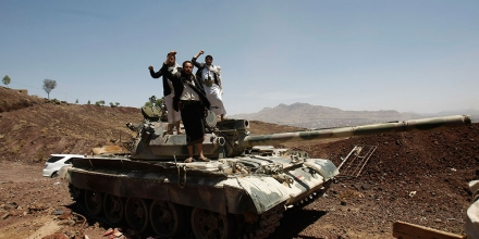 In this photo taken on Monday, Sept. 22, 2014, Hawthi Shiite rebels stand on a tank at the headquarters of the army's 1st Armored Division, in Sanaa, Yemen. (AP Photo/Hani Mohammed)