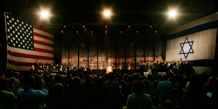 American Evangelical Pastor John Hagee addresses a crowd of his followers and Israeli supporters at a rally at the Jerusalem convention center, Sunday, April 6, 2008. American evangelist John Hagee on Sunday announced donations of $6 million to a number of Israeli causes and declared that Israel must remain in control of all of Jerusalem. Hagee, who has been in the news lately for his endorsement of U.S. Presidential candidate John McCain and his criticism of the Catholic Church, brought  hundreds of backers on a solidarity trip to Israel. Hagee's group, Christians United for Israel, gathered in Jerusalem to show solidarity with Israel and protest the land for peace agreements with the Palestinians. (AP Photo/Sebastian Scheiner)