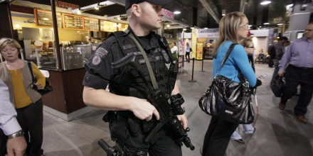 A Massachusetts Bay Transportation Authority Transit police officer carries an assault rifle while patrolling the North Station train station, in Boston, at rush hour Tuesday, Sept. 22, 2009. The government expanded a terrorism warning from transit systems to U.S. stadiums, hotels and entertainment complexes as investigators searched for more suspects Tuesday in a possible al-Qaida plot to set off hydrogen-peroxide bombs hidden in backpacks. (AP Photo/Steven Senne)