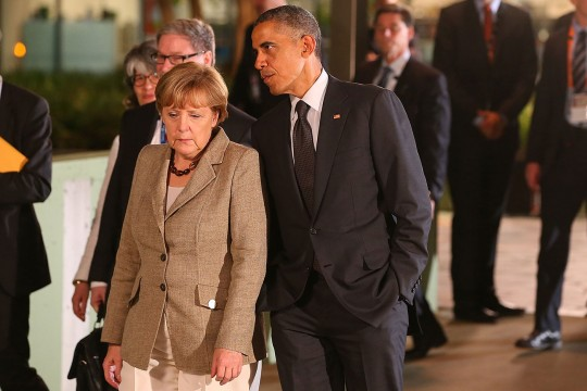 BRISBANE, AUSTRALIA - NOVEMBER 15:  United States President Barack Obama and Germany's Chancellor Angela Merkel arrive at The Queensland Gallery of Modern Art on November 15, 2014 in Brisbane, Australia. World leaders have gathered in Brisbane for the annual G20 Summit and are expected to discuss economic growth, free trade and climate change as well as pressing issues including the situation in Ukraine and the Ebola crisis. (Photo by Chris Hyde/Getty Images)