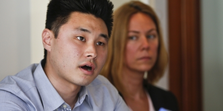 Student Daniel Chong talks about his ordeal while in the custody of the Drug Enforcement Administration when he was forgotten and left without food and water for five days at a news conference, Thursday, July 10, 2014, in San Diego. Chong is flanked by ACLU policy director Margaret Dooley-Sammuli. (AP Photo/Lenny Ignelzi)