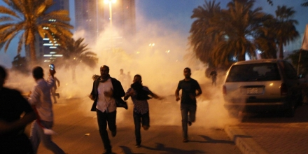 MANAMA, BAHRAIN - FEBRUARY 18:  Protesters run from a cloud of teargas during a clash with Bahraini security forces near the Pearl roundabout on February 18, 2011 in Manama, Bahrain. Protesters said that the army fired on them with live rounds, followed by teargas which drove the demonstrators back. There are unconfirmed reports that there are four dead in the clashes.  (Photo by John Moore/Getty Images)
