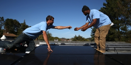 SAN RAFAEL, CA - FEBRUARY 26:  SolarCraft workers Craig Powell (L) and Edwin Neal install solar panels on the roof of a home on February 26, 2015 in San Rafael, California. According to a survey report by the Solar Foundation, the solar industry employs more workers than coal mining with nearly 174,000 people working in solar compared to close to 80,000 mining coal.  (Photo by Justin Sullivan/Getty Images)