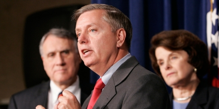 Sen. Lindsey Graham, R-S.C., center, accompanied by Sen. Jon Kyl, R-Ariz., left, and Sen. Dianne Feinstein, D-Calif., right, gestures during a  news conference on immigration legislation, Thursday, May 24, 2007, on Capitol Hill in Washington. (AP Photo/Susan Walsh)