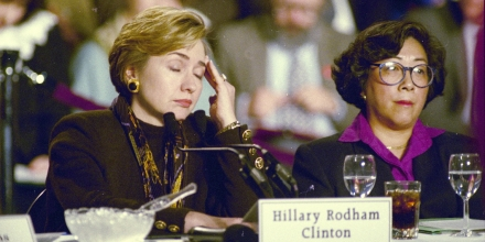 First lady Hillary Rodham Clinton touches her brow as she listens to a participant during the New England Summit on Health Care Reform at the World Trade Center in Boston, Dec. 7, 1993.  Clinton was the principal participant in a roundtable discussion on health care reform which lasted more than three hours.  Woman at right is unidentified.  (AP Photo/Jon Chase)