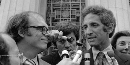 Co-defendants Anthony Russo, left, and Daniel Ellsberg talk to newsmen outside the Los Angeles Federal Building on May 10, 1973 after the Pentagon Papers trial judge stopped proceedings following revelation of additional wiretaps by the government. The judge ordered the government to find all records on electronic surveillance of Ellsberg immediately. (AP Photo)