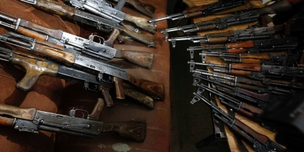 AK-47 weapons seized from two Britons along with their driver and interpreter are presented to the media in Kabul on January 5, 2012. Two British men arrested in Afghanistan with 30 AK47 assault rifles have been charged with the illegal smuggling of weapons, a government spokesman said on January 5. The men, Julian Steele and James Davis, were paraded before the media at a news conference which heard that they were detained while driving through Kabul and told police they were working for a private security company Garda World. AFP PHOTO/ STR (Photo credit should read STR/AFP/Getty Images)