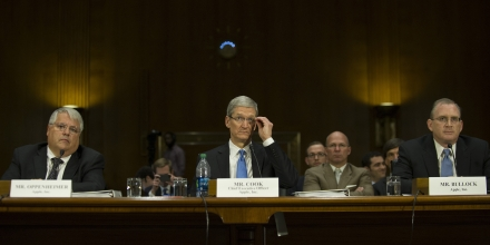 Apple Chief Executive Officer Tim Cook (C) testifies before the Permanent Subcommittee on Investigations about