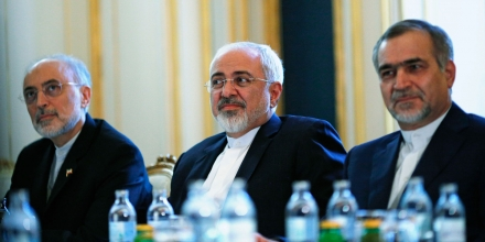Iranian Foreign Minister Mohammad Javad Zarif, centre, Head of the Iranian Atomic Energy Organization Ali Akbar Salehi, left, and Hossein Fereydoon, brother and close aide to President Hassan Rouhani, meet with U.S. Secretary of State John Kerry in Vienna, Austria, Friday July 3, 2015.  Iran has committed to implementing the IAEA's