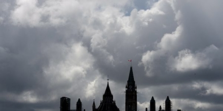 Storm clouds pass over Parliament Hill, Friday, May 22, 2015, in Ottawa, Ontario. (Adrian Wyld/The Canadian Press via AP) MANDATORY CREDIT