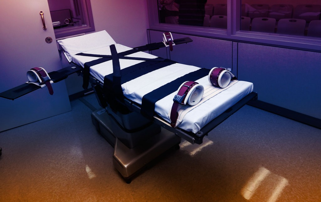 FILE - This Oct. 9, 2014, file photo shows the gurney in the the execution chamber at the Oklahoma State Penitentiary in McAlester, Okla. On Monday, June 29, 2015, The Supreme Court voted 5-4 in a case from Oklahoma saying that the sedative midazolam can be used in executions without violating the Eighth Amendment prohibition on cruel and unusual punishment.. (AP Photo/Sue Ogrocki, File)