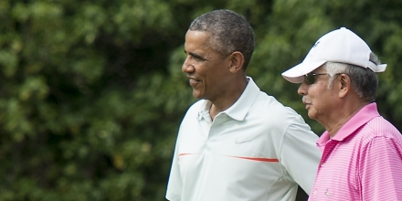 US President Barack Obama chats with Malaysian Prime Minister Najib Razzak as they play golf at Marine Corps Base Hawaii on December 24, 2014.   AFP PHOTO/Nicholas KAMM        (Photo credit should read NICHOLAS KAMM/AFP/Getty Images)