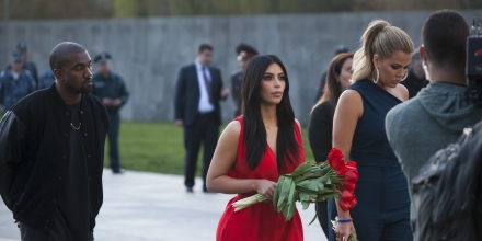 Kim Kardashian, center, her sister Khloe Kardashian, right, and  Kanye West, left, head to visit the memorial to the victims of genocide in Yerevan, Armenia, Friday, April 10, 2015.  The Kardashian sisters, along with Kim's husband Kanye West and their daughter North are in Armenia on a high-visibility visit ahead of this month's observation of the centennial of the mass killing of Armenians by Ottoman Turks. (AP Photo/Hrant Khachatryan, PAN Photo)