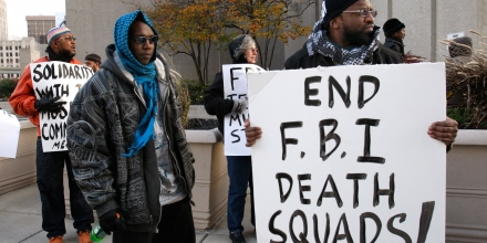 Akil Fahd, right, protests with others outside the McNamara Federal Building in Detroit, Thursday, Nov. 5, 2009. The protesters want an independent investigation into the death of Luqman Ameen Abdullah, a Detroit imam killed in a shootout with federal agents.   (AP Photo/Carlos Osorio)