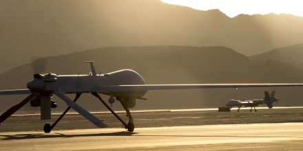 An MQ-1B Predator, left, and an MQ-9 Reaper taxi to the runway in preparation for takeoff June 13, 2014, on Creech Air Force Base, Nev. The aircraft are assigned to the 432nd Wing, which trains pilots, sensor operators and other remotely piloted aircraft crewmembers, and conducts combat surveillance and attack operations worldwide. (U.S. Air Force photo/Airman 1st Class Christian Clausen)