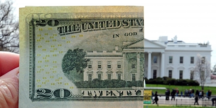 This March 25, 2009 photo illustration shows the reverse side of a US twenty dollar bill matched up with the north side of the White House in Washington, DC. US Treasury Secretary Timothy Geithner defended the dollar as a key global reserve currency on March 25, following China's call for a new global currency as an alternative to the greenback.  AFP PHOTO/KAREN BLEIER (Photo credit should read KAREN BLEIER/AFP/Getty Images)