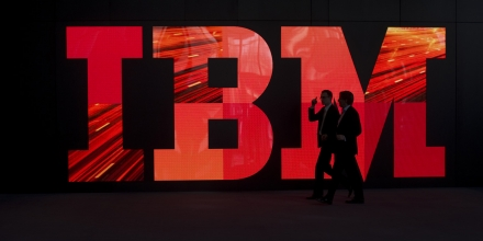 Two men walk past an IBM logo during preparations for the CeBIT IT fair on February 28, 2011 in Hanover, central Germany. The world's top high-tech fair opens for the public on March 1, 2011 with the IT industry in bullish mood, preparing to wow visitors with head-spinning futuristic gadgets and the latest in 'cloud computing' technology. More than 4,200 tech firms from 70 countries are expected to attend this year's CeBIT -- the self-styled