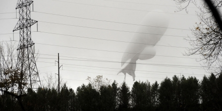An unmanned Army surveillance blimp floats through the air while dragging a tether line just south of Millville, Pa., Wednesday, Oct. 28, 2015. The bulbous, 240-foot helium-filled blimp came down near Muncy, a small town about 80 miles north of Harrisburg. The North American Aerospace Defense Command in Colorado said the blimp detached from its station at the military's Aberdeen Proving Ground in Maryland.  (Jimmy May/Bloomsburg Press Enterprise via AP)
