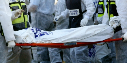 Israeli police officers and Zaka rescue and recovery volunteers remove  bodies at the scene of a double bus bombing in the southern Israeli city of Beersheba, Tuesday Aug. 31, 2004. Two buses blew up in the southern Israeli city on Tuesday, killing at least 15 people and wounding more than 80 others, in what appeared to be the first Palestinian suicide bombings inside Israel in six months, rescue officials said. (AP Photo/Brennan Linsley)