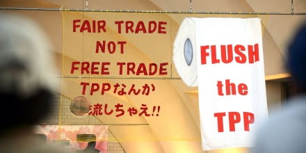 Signs are displayed during a protest against the Trans-Pacific Partnership (TPP) trade agreement at Yoyogi Park in Tokyo, Japan, on Tuesday, May 26, 2015. A former Japanese agriculture minister is suing the government over a U.S.-led Pacific trade agreement supported by Prime Minister Shinzo Abe, claiming it threatens Japans food security and farm industry. Photographer: Akio Kon/Bloomberg via Getty Images