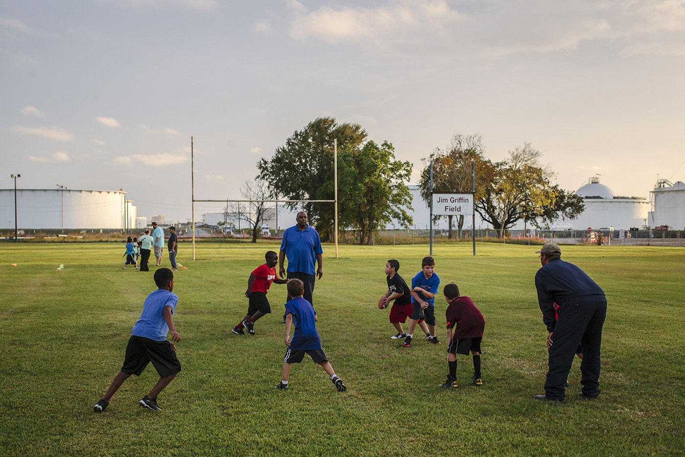 A Westlake Recreation League football team practices at Jim Griffin Field, across the street from the Phillips 66 refinery, Westlake, La., Oct. 22, 2015.