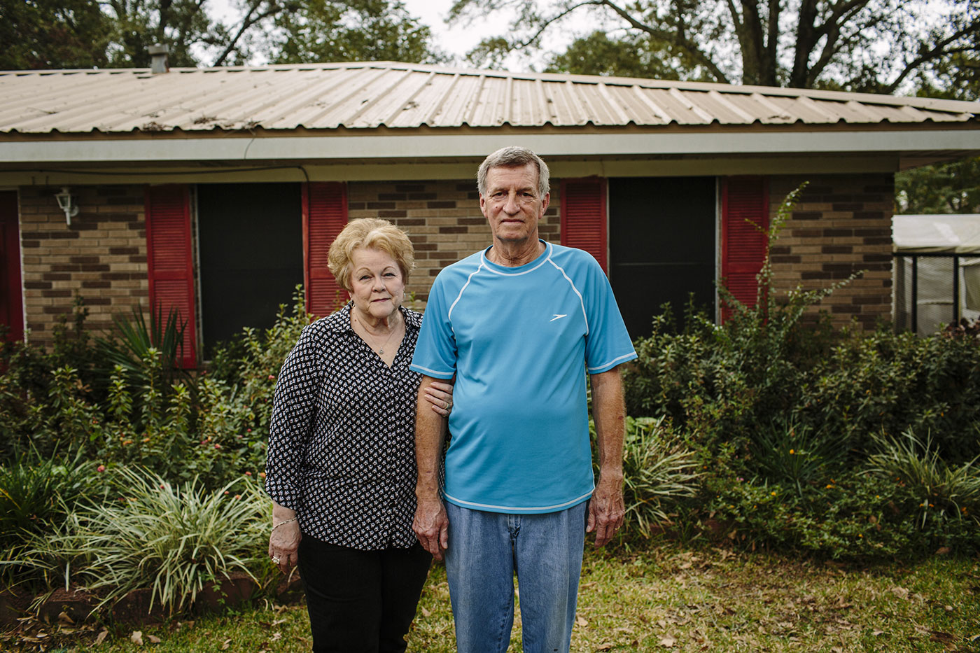 Rose and Dale Luttrell stand in their front yard in downtown Westlake, La., Oct. 22, 2015.