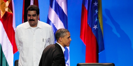 President Barack Obama walks past the empty seat of Nicaragua as he leaves the opening ceremony of the sixth Summit of the Americas after shaking hands with Venezuela's Prime Minister Nicolas Maduro, left, in Cartagena, Colombia, Saturday April 14, 2012.  Nicaragua's President Daniel Ortega did not attend the hemispherical meeting. (AP Photo/Fernando Vergara)