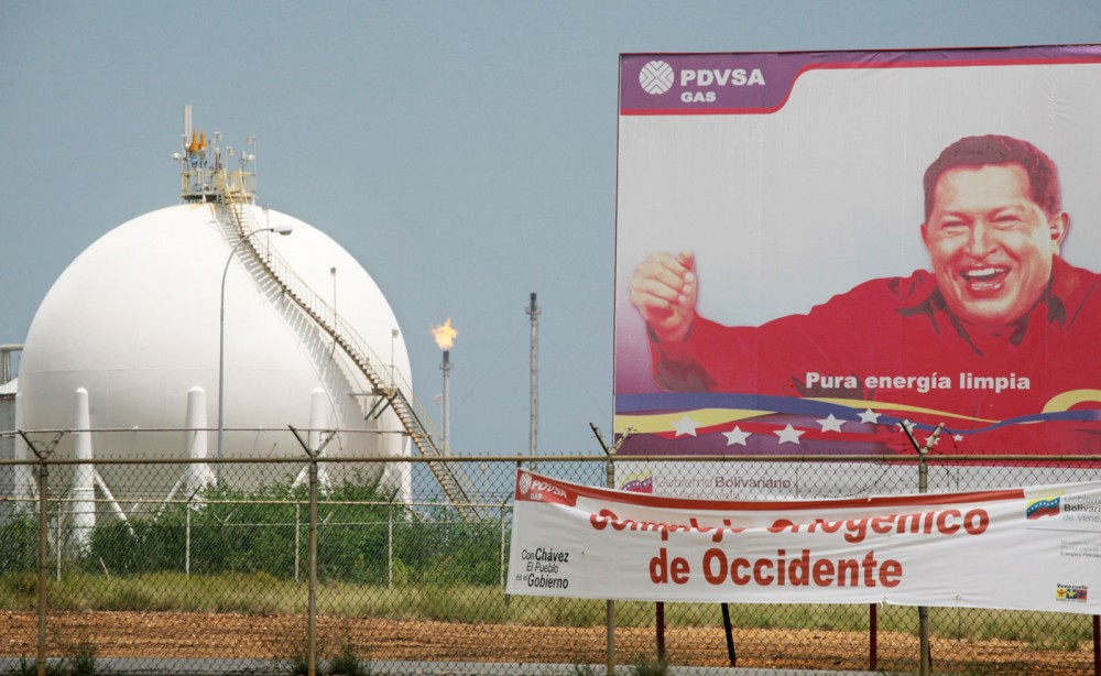 A signs shows Venezuelan President Hugo Chavez at the gas processing plant in the  Complex  Jose in Anzoategui state, 200 miles East from Caracas, Venezuela. The complex, that make refined crude from the heavy oil of the Orinoco Belt, is a joint venture between Venezuelan state owned PDVSA and the foreign companies Chevron, British Petrolum, Total and Statoil. May 1st 2007 Venezuelan President Hugo Chavez changed the stock holding of the complex to make PDVSA ,with 60 percent of the stocks , control the participating companies.Photographer Diego Giudice/Bloomberg News
