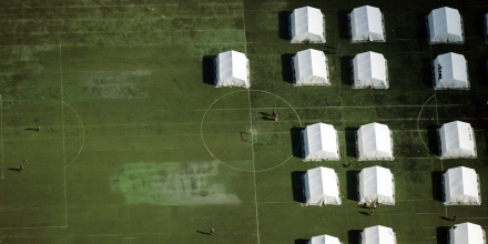 Aerial view of tents at a camp for asylum-seekers on the grounds of the former army barracks Schmidt-Knobelsdorf-Kaserne in Berlin on September 9, 2015. Germany has said it is expecting to welcome 800,000 asylum-seekers this year, four times more than a year ago and far more than any other EU countries.  AFP PHOTO / DPA / RALF HIRSCHBERGER +++ GERMANY OUT        (Photo credit should read RALF HIRSCHBERGER/AFP/Getty Images)