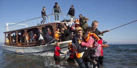 Greek and Norwegian volunteers help a boat full of Syrian refugees to disembark after arriving on the  sea-shore at the north part of Lesvos island, Greece after crossing the  Aegean Sea from Turkey ovember 12 ,2015. The  small Greek island of Lesvos ,once known as a  tourist destination has now become  the center of the European refugee crisis .(Photo by Heidi Levine/Sipa Press).