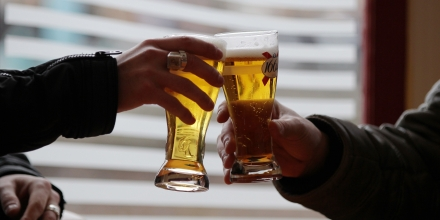 Two men make a toast prior to drink a beer at a bar table on March 10, 2015 in Pont-Audemer, northwestern France. AFP PHOTO/CHARLY TRIBALLEAU.        (Photo credit should read CHARLY TRIBALLEAU/AFP/Getty Images)