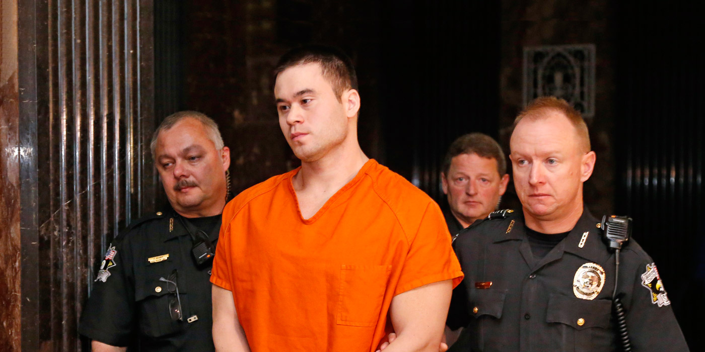 Daniel Holtzclaw is led from a courtroom in Oklahoma City, Friday, Oct. 30, 2015.  Holtzlcaw's trial on charges alleging he sexually assaulted women while on duty is set to begin on Moday, Nov. 1, 2015. (AP Photo/Sue Ogrocki)