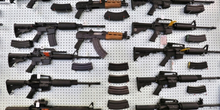 FILE - In this July 20, 2014, file photo, guns are displayed for sale at Dragonman's, an arms seller east of Colorado Springs, Colo. Republicans who have spent two years criticizing limits on the size of ammunition magazines will start advancing a repeal of the 2013 Colorado law passed by Democrats in response to mass shootings. A bill to strike the law is expected to pass a Republican-led Senate committee Monday, March 9, 2015. GOP lawmakers tried repealing the law last year, but Democrats controlled both legislative chambers and they rejected the proposal. (AP Photo/Brennan Linsley, File)