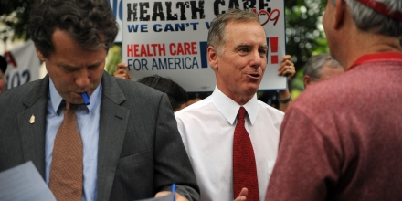 US politician and physician Howard Dean (C) with Senator Sherrod Brown (L) D-OH prepare to address a massive rally titled