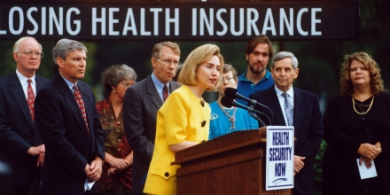 16 Aug 1994, Washington, DC, USA --- First Lady Hillary Rodham Clinton speaks in front of a counter which shows one person losing health insurance every 1.17 seconds. --- Image by © Reuters/CORBIS