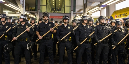 MINNEAPOLIS, MN -  DECEMBER 23:  Police queue up at the Minneapolis-St. Paul International airport Lightrail stop, where a number of Black Lives Matter protestors attempted to enter the airport on December 23, 2015 in Minneapolis, Minnesota. Black Lives Matter Minneapolis staged a brief protest at the Mall of America in Bloomington, MN before moving their protest to the airport. (Photo by Stephen Maturen/Getty Images))