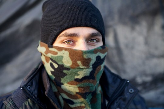 "Mohamed Salim, a former Afghan Special Forces soldier, is seen in the refugee camp known as ""The Jungle"" in Calais, France, 04 December 2015. Conditions are deteriorating rapidly in the camp of an estimated 6,000 people as winter approaches, increasing the desperate attempts to break though fences and stowaway on trucks or trains, attempts that have seen 18 refugees die since June 2015. (John D McHugh/Verifeye Media)"