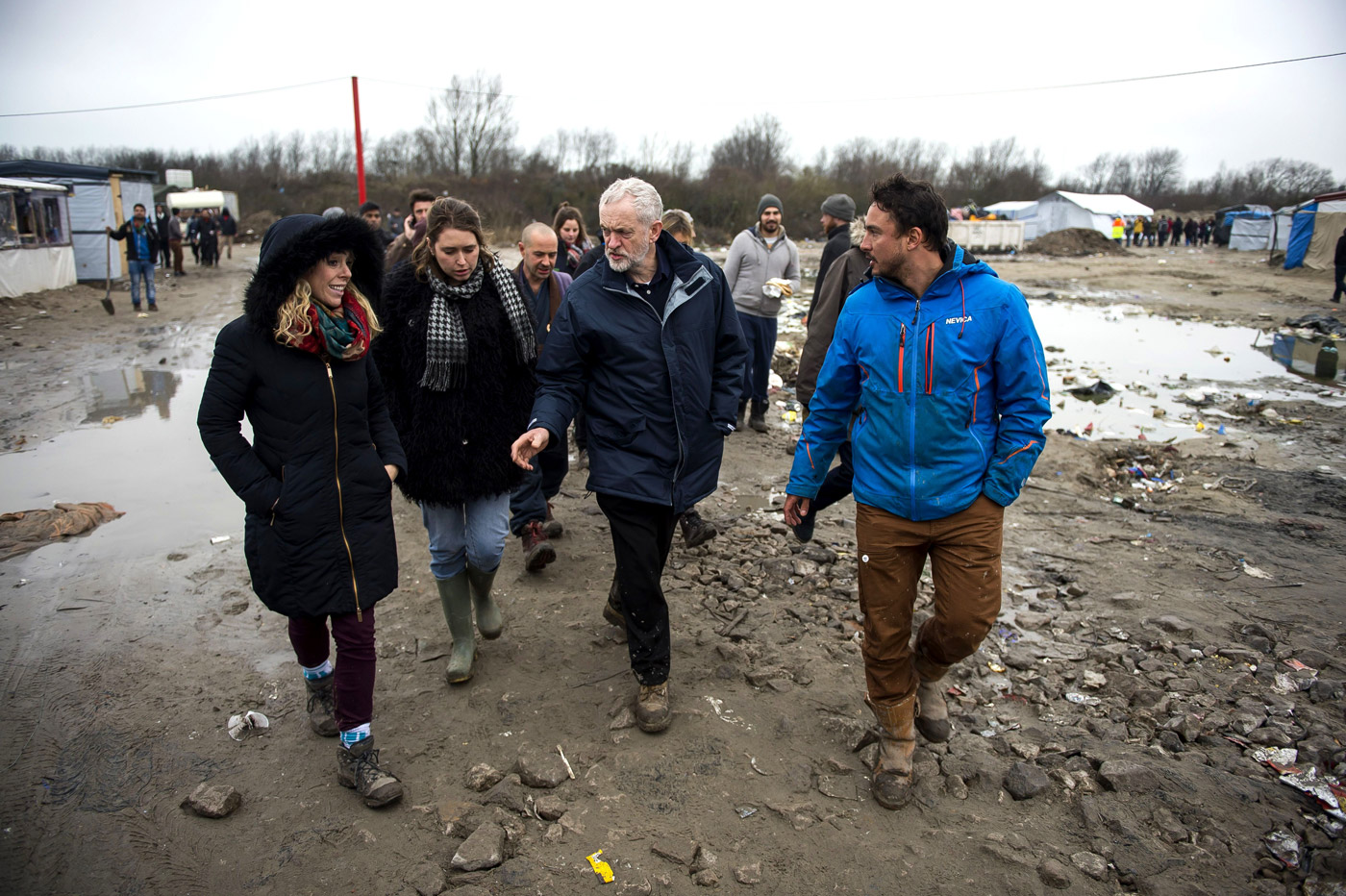 Leader of the Labour Party Jeremy Corbyn visits the camp known as the 'Jungle' in Calais, France, where thousands of migrants and refugees attempting to reach the UK are currently living. Jeremy Corbyn visits 'The Jungle', Calais, France - 23 Jan 2016(Rex Features via AP Images)