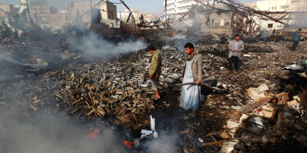 Yemeni men inspect the damage at the site of a Saudi-led coalition air strike which hit a sewing workshop, in the capital Sanaa, on February 14, 2016.The factory owner, Faisal al-Musaabi, told AFP that