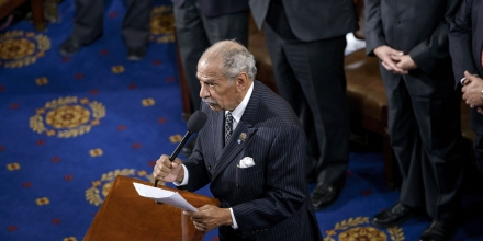 Rep. John Conyers, D-MI, administers an oath during a swearing-in ceremony in the House of Representatives as the 114th Congress convenes on Capitol Hill January 6, 2015 in Washington, DC. Republican John Boehner was re-elected and sworn in Tuesday as speaker of the US House of Representatives, overcoming a surprisingly robust attempt to oust him by two dozen hardcore conservatives. Boehner received 216 of the 408 votes cast in the chamber, winning as expected over Democrat leader and former House speaker Nancy Pelosi, who received 164 votes.  AFP PHOTO/BRENDAN SMIALOWSKI        (Photo credit should read BRENDAN SMIALOWSKI/AFP/Getty Images)